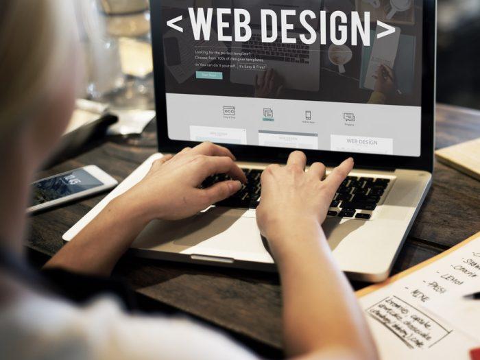 Web designer on laptop