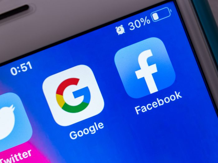 Google and Facebook app icons showing on mobile device